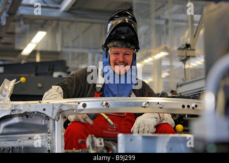 Welder wearing protective mask, Audi R8 construction at the Audi Plant in Neckarsulm, Baden-Wuerttemberg, Germany, - Stock Photo