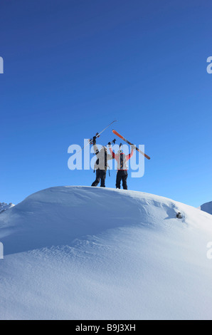 Skiers on top of mountain - Stock Photo