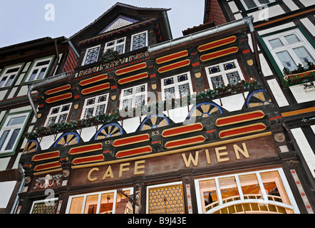 Cafe in a historic frame house, Wernigerode old town, Harz, Saxony-Anhalt, Germany, Europe - Stock Photo