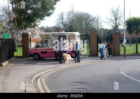 People queueing up to buy ice cream from an ice cream van in Weybridge Surrey - Stock Photo