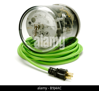 Electric power meter on a coiled green electrical extension cord and plug - Stock Photo