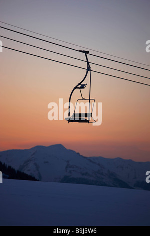 Mountain view at dusk with chair lift - Stock Photo