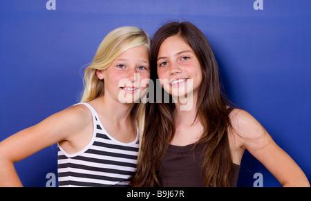 Two girls, eleven years, girlfriends, portrait - Stock Photo
