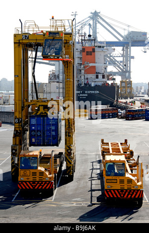 Container being loaded onto a truck - Stock Photo
