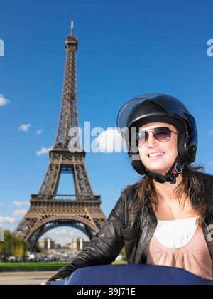 Woman on moped in Paris - Stock Photo