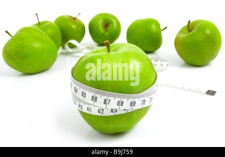 Green apples measured the meter sports apples - Stock Photo