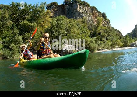 Young girl and mother doing kayak - Stock Photo