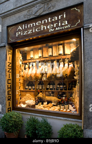 Display window of a ham and wine store in the historic centre of Siena, Tuscany, Italy, Europe - Stock Photo