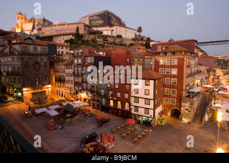 Cais da Ribeira, Ribeira Quay and historic town centre, at back the towers of the Sé Catedral Cathedral, Porto, - Stock Photo