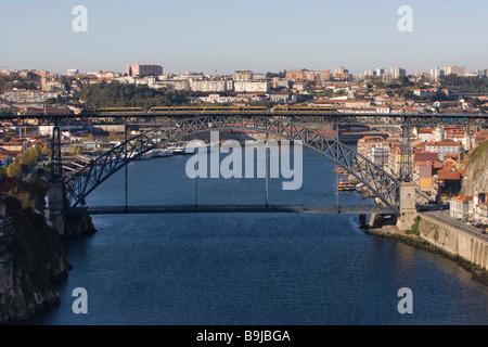 View from Maria Pia Bridge to Porto with River Rio Duoro, at the back Porte de Luis Bridge, Porto, UNESCO World - Stock Photo