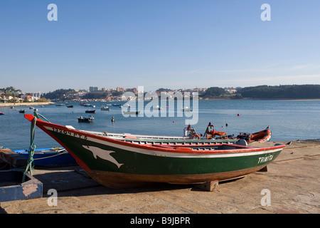 Fishing boat on the Rio Duoro River, Ponte da Arrabida Bridge at back, Porto, UNESCO World Cultural Heritage Site, - Stock Photo