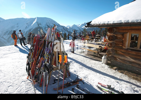 Skis standing on the Heitwanger Hochalm mountain pasture, at back Mount Roter Stein, 2366 m, Mount Aelple, 1663 - Stock Photo