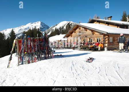 Skis standing on the Heitwanger Hochalm mountain pasture, Bichelbach, Tyrol, Austria, Europe - Stock Photo