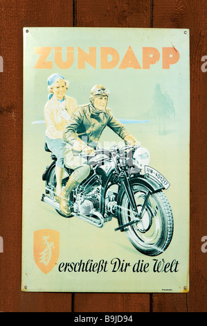 Old motorbike advertisement on a tin sign, on a wooden gate, Wichsenstein, Upper Franconia, Bavaria, Germany, Europe