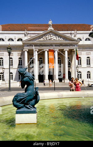 Teatro Nacional Dona Maria II, classicist national theatre on Rossio Square, in the front a fountain with sculptures - Stock Photo