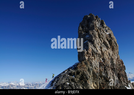 Skiers on Tour Saint Martin, Col du Pillon, skiing region Glacier 3000, Gstaad, Western Alps, Bernese Oberland, - Stock Photo