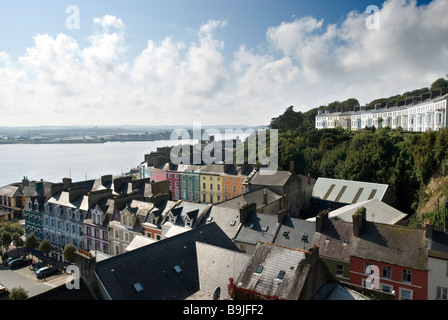 View over the colourful coastal town of Cobh from St Colman's Cathedral on a bright sunny day, County Cork, Ireland - Stock Photo