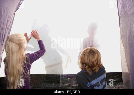 ... Children making shadows on tent - Stock Photo & A shadow of a boy on a tent Stock Photo Royalty Free Image ...