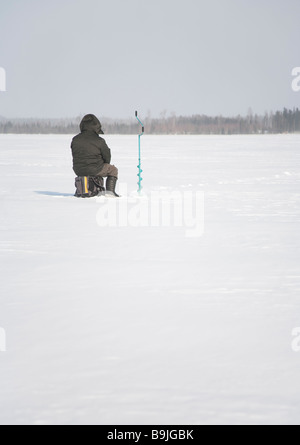 Ice fishing in Finland - Stock Photo