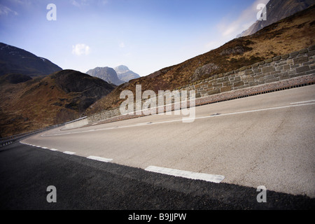 new road,sweeping curve,blue sky,no traffic. - Stock Photo