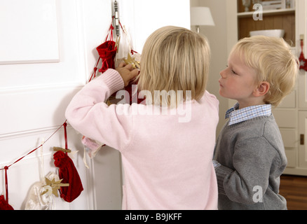 girl boy advent-calendars little sack view - Stock Photo