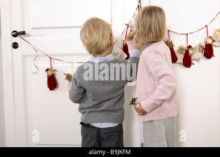 girl boy advent-calendars little sack back view view  3-4 years advent advent-calendar considerations siblings inner - Stock Photo