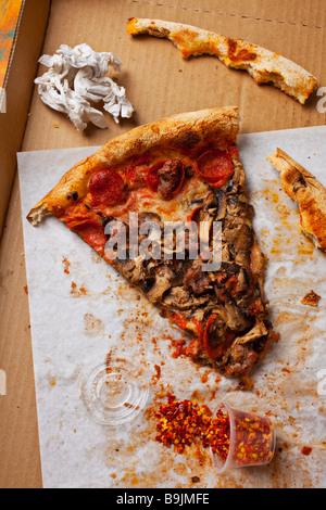 Last slice of pizza left in box - Stock Photo