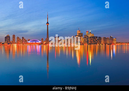 Toronto City Skyline seen at dusk from Centre Island Toronto Islands Lake Ontario Ontario Canada - Stock Photo