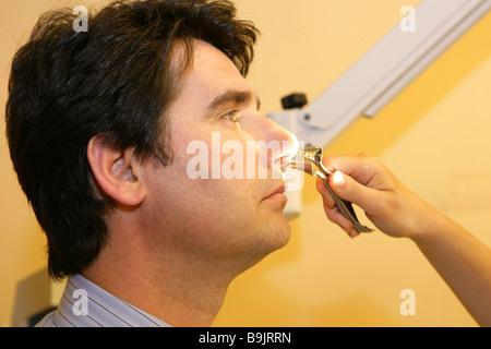 ENT physician man examination - Stock Photo