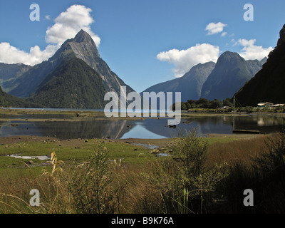 Milford Sound and Mitre Peak at low tide - Stock Photo
