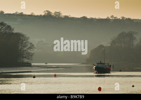A Boat moored at dusk on the River Teifi at Cardigan Ceredigion Wales UK - Stock Photo
