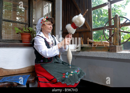 Bulgaria, Black Sea region, Bata, cotton spinner in traditional outfit - Stock Photo