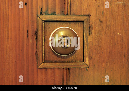 Old fashioned light switch in wood panel - Stock Photo