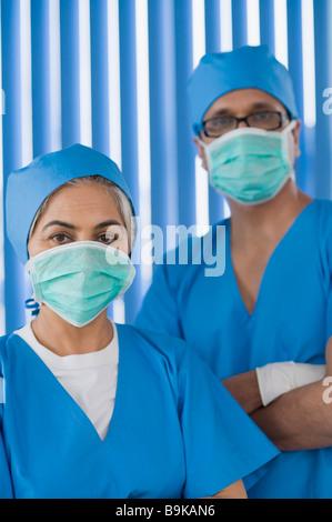 Portrait of surgeons wearing surgical masks - Stock Photo