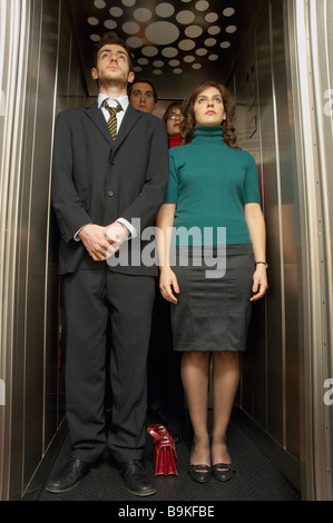 people standing in elevator. group of business people standing in elevator - stock photo l