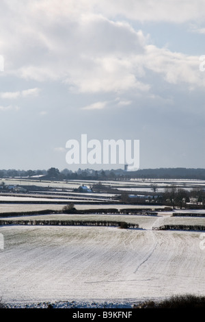 A snowy landscape over farmland; Somerset, England, UK: February 2009 - Stock Photo