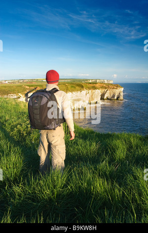A visitor enjoying the view from the cliff tops on the Flamborough Headland Heritage Coast East Riding of Yorkshire - Stock Photo
