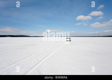 Toyota Avensis 2007 sedan driving on frozen lake ice . Lake Keitele , Finland - Stock Photo