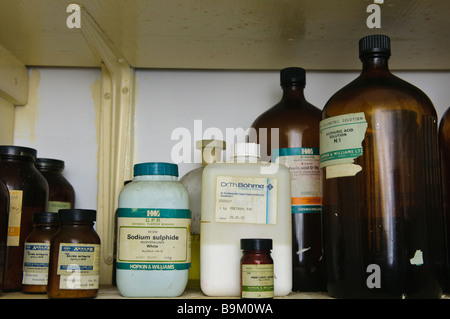 Chemicals on a shelf in a laboratory - Stock Photo