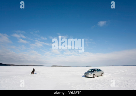 Ice fishing at Lake Keitele Finland , using car ( Toyota Avensis 2007  ) - Stock Photo