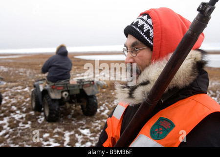 Canadian Ranger with rifle on training exercise, portrait, Canadian Arctic, Canada - Stock Photo