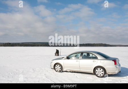 Ice fishing using car ( Toyota Avensis 2007 ) at Lake Keitele , Finland - Stock Photo