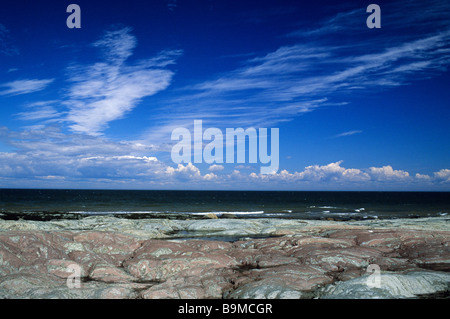 Canada, Quebec Province, Bas Saint Laurent Region, colorful rocks on Saint Laurent River banks towards Rimouski - Stock Photo