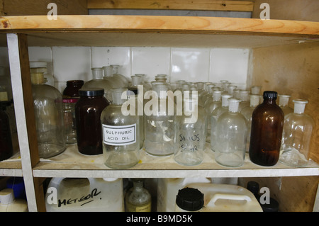 Empty glass bottles and jars on a shelf in a laboratory - Stock Photo