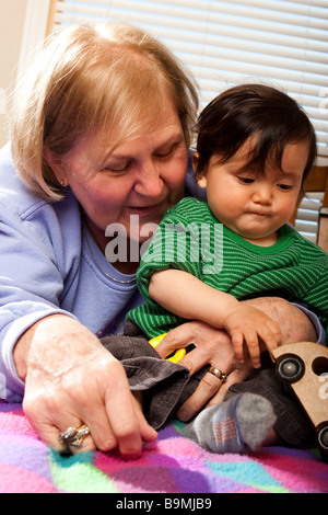 A ten month old baby playing - Stock Photo