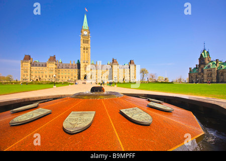 Centre Block and Peace Tower of the Parliament Buildings and the Centennial Flame Parliament Hill Ottawa Ontario - Stock Photo