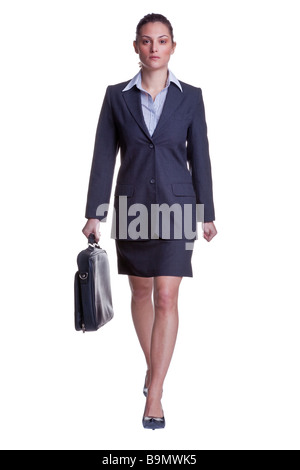 Businesswoman in suit walking towards carrying a briefcase isolated on white background - Stock Photo