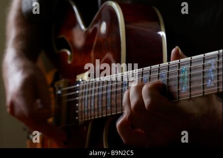 Guy playiing electric jazz guitar - Stock Photo