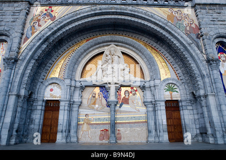 France, Hautes Pyrenees, Lourdes, tympanum of the Rosary Basilica with the Virgin Mary appeared to Bernadette with - Stock Photo