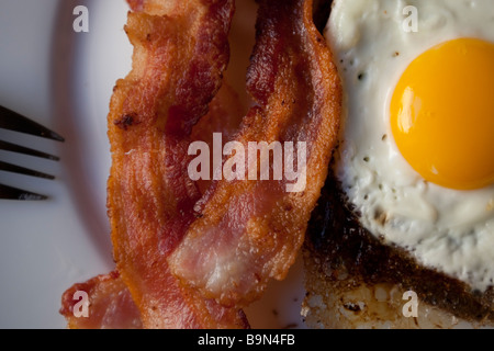 eggs and bacon on a plate for breakfast - Stock Photo